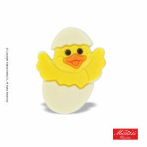 Martinez φιγούρα απο λευκή σοκολάτα σε σχέδιο κοτοπουλάκι σε πασχαλινό αυγό. Ιδανικό για το Πάσχα.