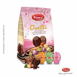 Πασχαλινό αυγουλάκι Witor's με επικάλυψη σοκολάτα γάλακτος ή υγείας, γέμιση από πραλίνα φουντουκιού και τραγανά δημητριακά (crispies), τυλιγμένα σε πολύχρωμα σχέδια με λουλούδια. Ιδανικό για Πάσχα.