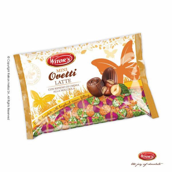Πασχαλινό αυγουλάκι Witor's με επικάλυψη σοκολάτα γάλακτος και γέμιση από πραλίνα φουντουκιού ή λευκή κρέμα, τυλιγμένα σε πολύχρωμα σχέδια με καρδιές. Ιδανικό για Πάσχα.
