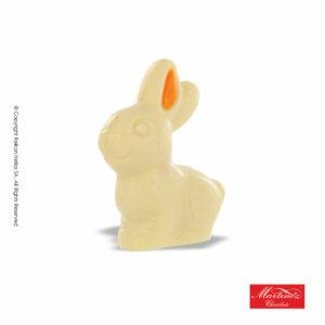 Martinez φιγούρα από σοκολάτα λευκή και γέμιση πραλίνας φουντουκιού σε σχέδιο λαγός με πορτοκαλί αυτάκι. Ιδανικό για το Πάσχα.