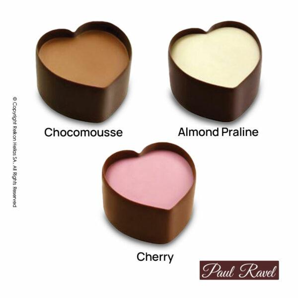 Πραλίνες σοκολάτας γάλακτος σε 3 γεύσεις: μους σοκολάτας, κεράσι και πραλίνα αμυγδάλου πραλίνας.